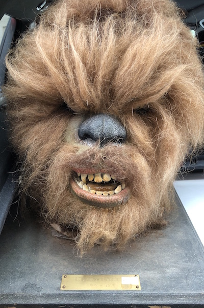 The world's ONLY Wookie Wishing Well! DotCom Comics and Collectibles is raising money for charity by offering wishes on Chewbacca's head. Yes, really